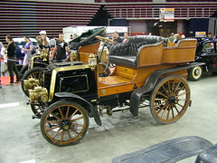 carriage(0.0), automobile(1.0), wheel(1.0), vehicle(1.0), auto show(1.0), touring car(1.0), antique car(1.0), vintage car(1.0), land vehicle(1.0), ford model t(1.0), motor vehicle(1.0),