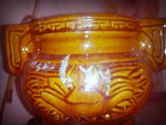 pumpkin(0.0), glass(0.0), produce(0.0), jack-o'-lantern(0.0), lighting(0.0), amber(1.0), carving(1.0), art(1.0), orange(1.0), yellow(1.0), pottery(1.0), amber(1.0),