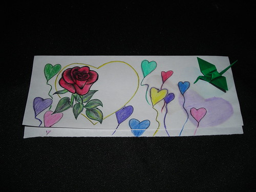 Rose, heart balloons and crane