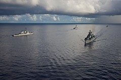 PHILIPPINE SEA (Oct. 15, 2011) The guided-missile destroyer USS Fitzgerald (DDG 62) steams opposite the RFS Varyag, a Russian Federation Navy Slava class cruiser, during a pass and review ceremony during the closing of exercise Pacific Eagle. (U.S. Navy photo by Cmdr. Jason W. Orender)