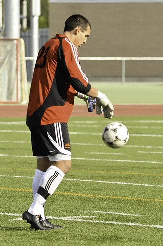 Travis Froehlich prepares to kick ball (vertical Oct 1, 2011 Devon Lindsay)