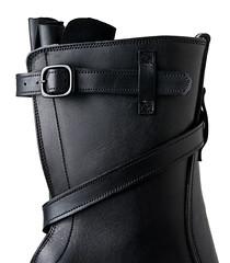bag(0.0), arm(0.0), footwear(0.0), handgun holster(0.0), limb(0.0), leg(0.0), human body(0.0), shoe(1.0), leather(1.0), motorcycle boot(1.0), boot(1.0),