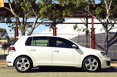 volkswagen golf mk5(0.0), automobile(1.0), automotive exterior(1.0), family car(1.0), wheel(1.0), vehicle(1.0), volkswagen golf mk6(1.0), volkswagen gti(1.0), city car(1.0), bumper(1.0), land vehicle(1.0), hatchback(1.0), volkswagen golf(1.0),