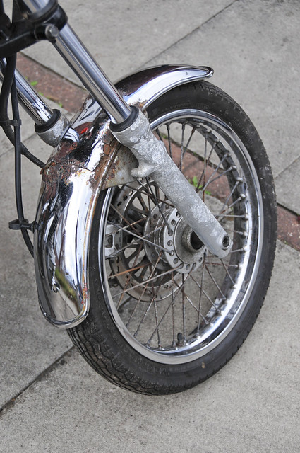 Suzuki TU250X Motorcycle, Motorbike, 2000 Model in Silver (front wheel  detail)