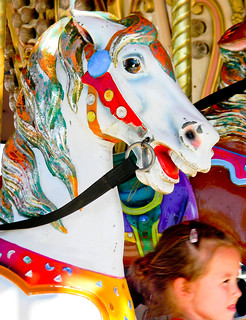 horse and girl on a carousel