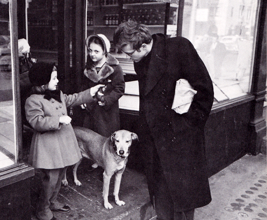 James Dean and little girl holding a chicken head