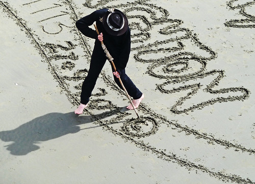 The Sand Artist creating copyright
