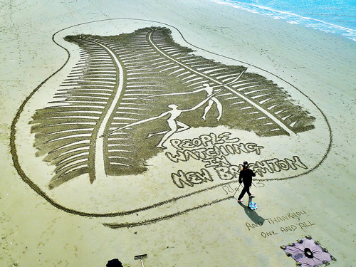 People Watching - The Sand Artist
