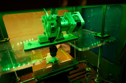 picture of a 3D printer making a plastic toy