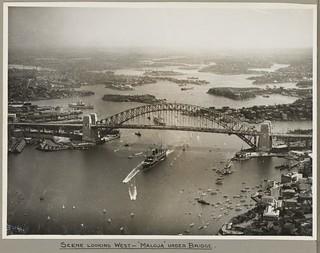 The mail ship Maloja passing under Sydney Harbour Bridge, 19 March 1932