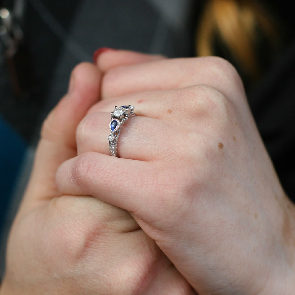 Hands. The ring.