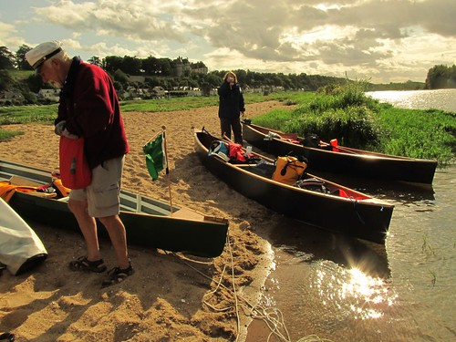 Travelling in quickly built home made canoes on the Loire River in France.