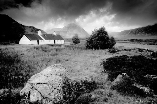 black clouds scotland scenery cottage
