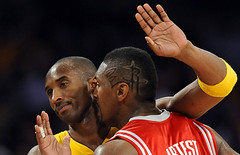 The Los Angeles Lakers' Kobe Bryant (left) and the Houston Rockets' Ron Artest exchange pleasantries during a second-round NBA basketball playoff series in Los Angeles, by Chris Carlson