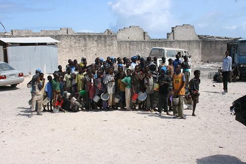 Children queue for food aid in Mogadishu, Somalia, August 2011