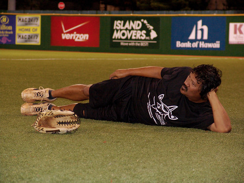 <p>A Dillinghamma player takes a break between games. Every team played at least twice in the UH AUW Softball Tourment at Les Murakami Stadium on Sept. 30, 2011</p>