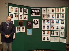 Michael Scott Karpovitz with his wall of fame