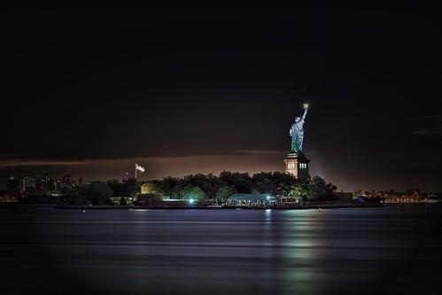 nyc newyorkcity longexposure light cloud ny newyork reflection statue brooklyn night liberty newjersey nikon jerseycity flag nj americanflag hudsonriver gothamist statueofliberty hdr d300 newyorkharbor mudpig stevekelley stevenkelley
