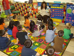 Children's Librarian reading to school kids.