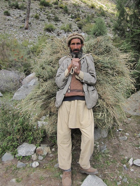 Man carrying straw.