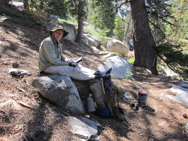 Relaxing on the Fuller Ridge Trail, cooling my feet and reading a book