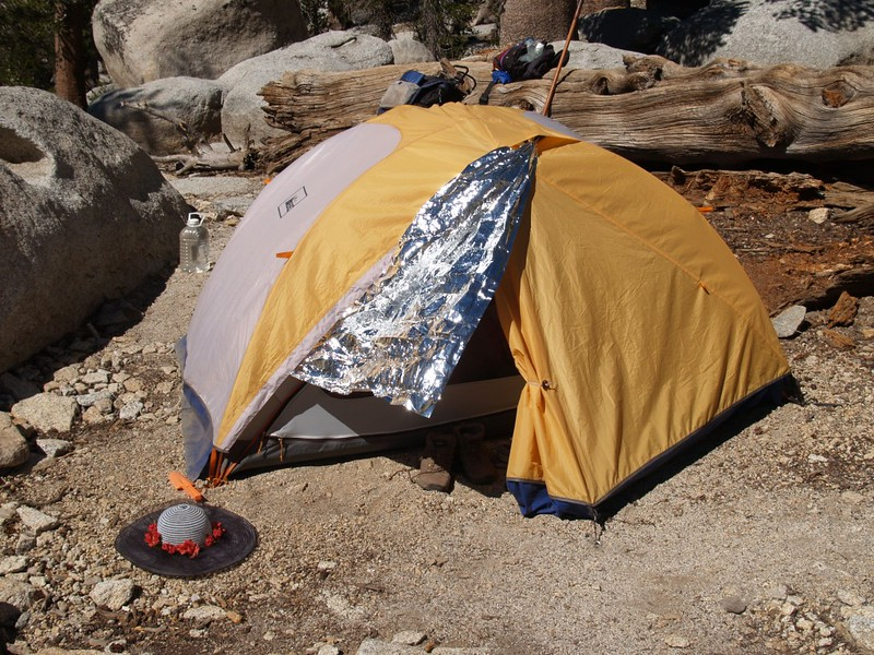 Our tent in the hot sun with additional space blanket shading - it works!
