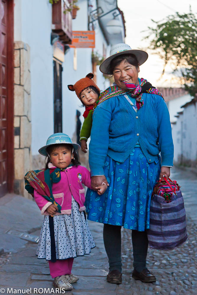 Cuzco, Peru, woman in blue with two children