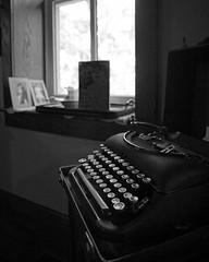 darkness(0.0), typewriter(1.0), white(1.0), photograph(1.0), office equipment(1.0), monochrome photography(1.0), still life photography(1.0), monochrome(1.0), black-and-white(1.0), black(1.0),