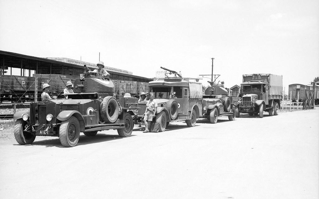 British soldiers and armoured cars at Lydda Railway station, Palestine - circa 1938