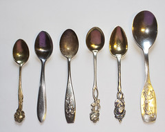 six ornate spoons