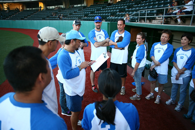 <p>Keith Kashiwada (holding clipboard) assigned positions and batting order for the Kapiolani team in the the UH AUW Softball Tourment at Les Murakami Stadium on Sept. 30, 2011</p>