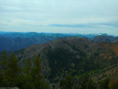 Cloudy view across the Teanawy of Washington toward the snowy Cascades from Earl Peak
