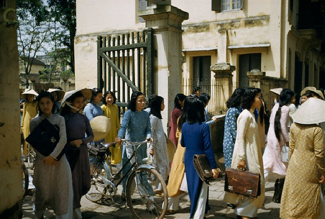 Hanoi 1952 - Students on a lunch break leave school with briefcases and bicycles