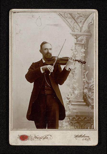 Alexander Bull with violin portrait