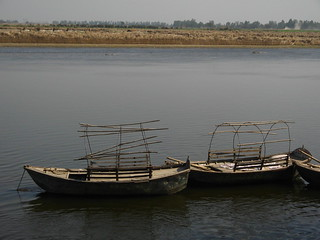 Photo of two boats moored on the bank of the Ganga