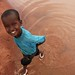 Somali kid playing with water at kambioos refugee camp, dadaab, kenya by Jordan Pouille