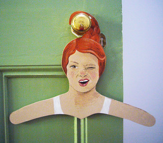 redhead hanger on green door
