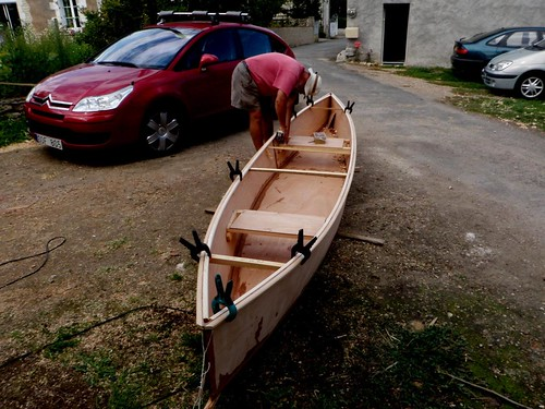 "Paul Helbert fitting inwales to the plywood ""Quick Canoes"" built in France for a trip on the Loire River the week after."