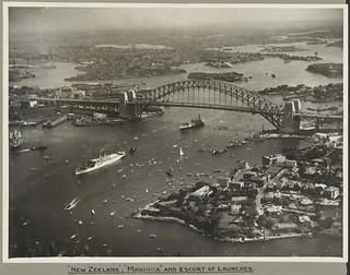 The ships New Zeeland and Manunda passing under Sydney Harbour Bridge, 19 March 1932
