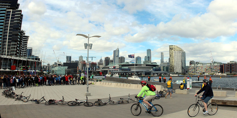 Two cycle tourists check out Moving Planet Melbourne 350 climate event Panorama