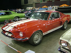 first generation ford mustang(0.0), convertible(0.0), automobile(1.0), automotive exterior(1.0), wheel(1.0), vehicle(1.0), automotive design(1.0), auto show(1.0), shelby mustang(1.0), antique car(1.0), land vehicle(1.0), muscle car(1.0), coupã©(1.0), sports car(1.0),