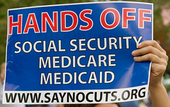 Sign: Hands Off Social Security Medicare Medicaid www.saynocuts.org by Fifth World Art