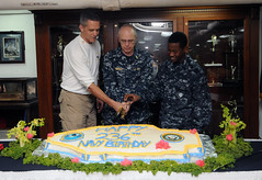 The day before arriving in Singapore for a port visit, Commanding Officer David A. Lausman, left, helps the oldest and youngest Sailors assigned to aircraft carrier USS George Washington (CVN 73) cut a cake commemorating the Navy's 236th birthday. (U.S. Navy photo by Aviation Boatswain's Mate (Equipment) 3rd Class Sandip K. Dhesi)