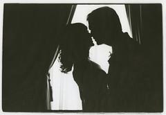 Couple in window - a monochrome
