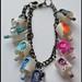 rainbow black dot charm bracelet by sars infection