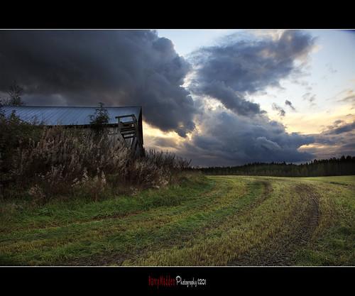 sunset tractor barn suomi finland tracks stormy farmersfield