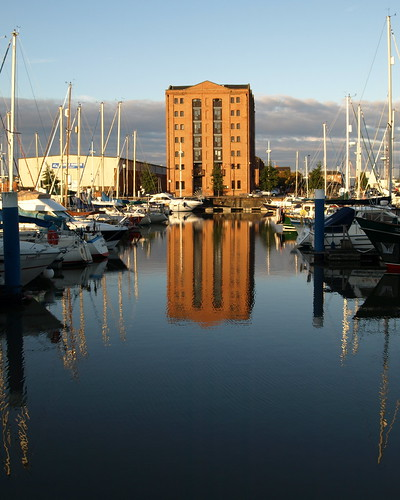 hull humberside eastyorkshire yorks east uk england britush stock image photo ©2011tonyworrall marina docks harbour wet water ships boats blue docked shimmer building warehouse architecture scenic nice cityofculture hullcityofculture city culture visit tour place tourist imagesofhull hullphotos reflections