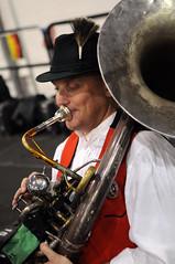 drummer(0.0), trumpet(0.0), sousaphone(1.0), musician(1.0), tuba(1.0), musical instrument(1.0), music(1.0), brass instrument(1.0), person(1.0),