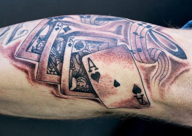 Arm cards tattoo
