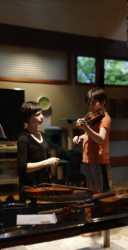 amy giving nick a violin lesson in our living room